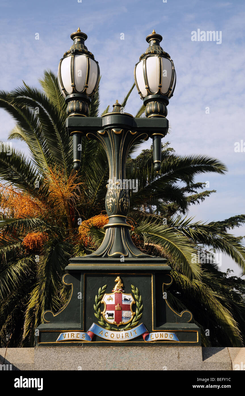 Ornamental cast iron lamp with coat of arms on Princes Bridge over Yarra River Melbourne Australia - Stock Image