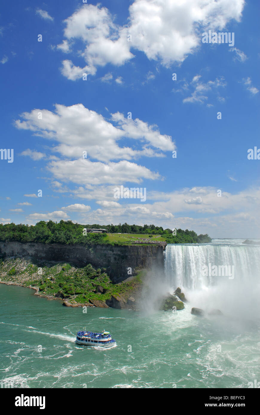 Boat tour coming very close to Niagara Falls - Stock Image
