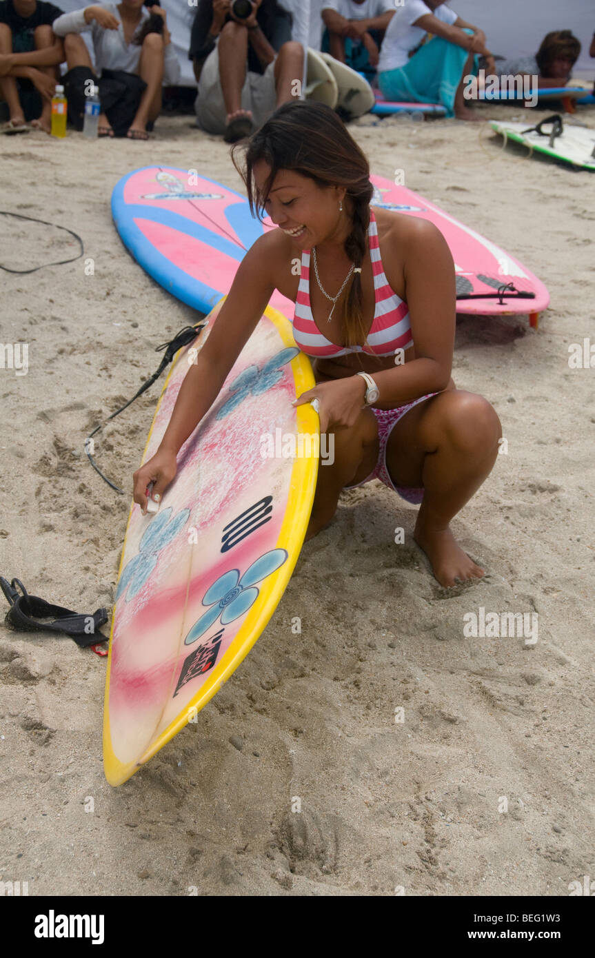 lady surfer at Kuta Beach in Bali Indonesia - Stock Image
