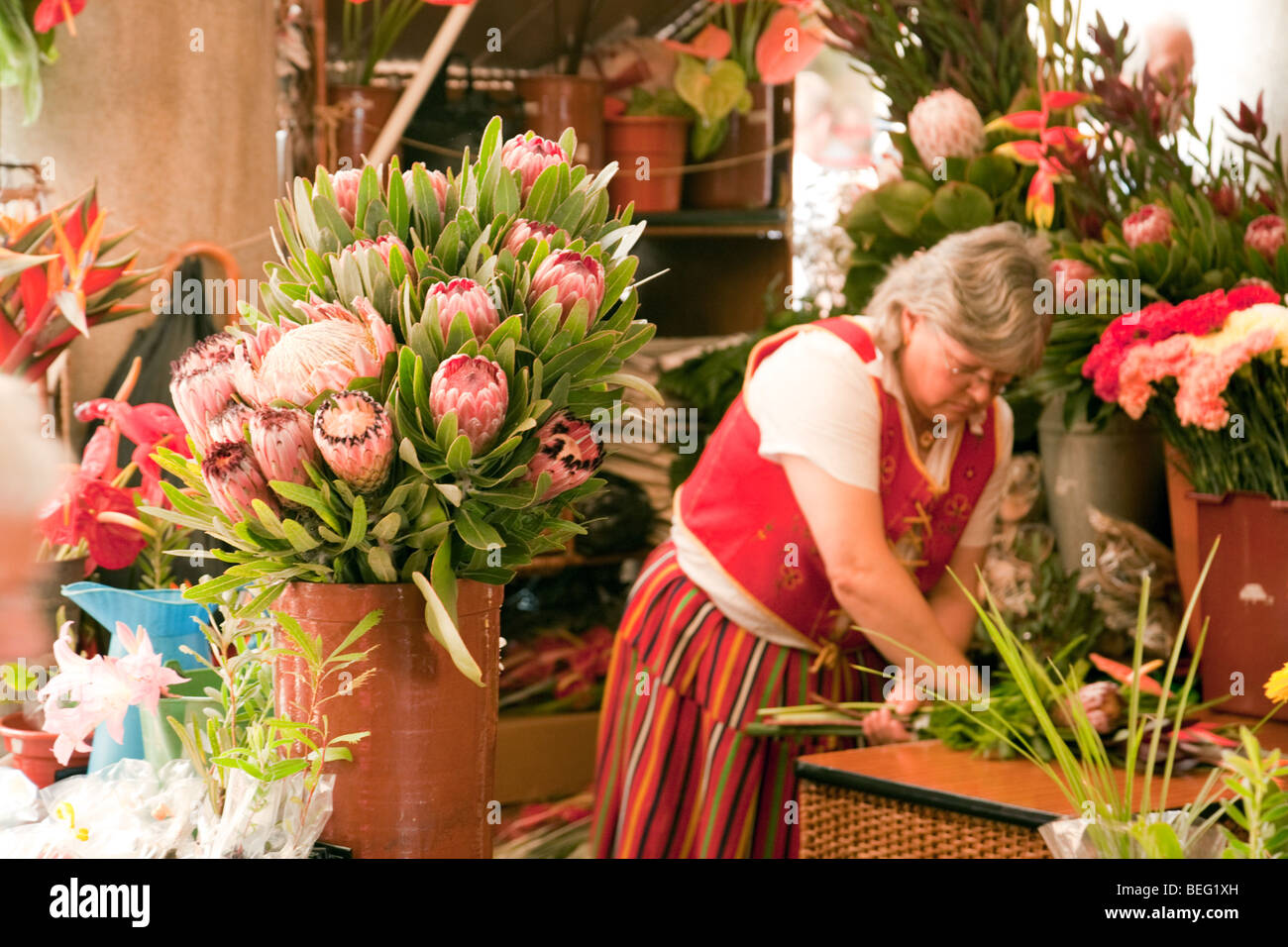 Selling flowers at the flower market, Funchal., Madeira - Stock Image
