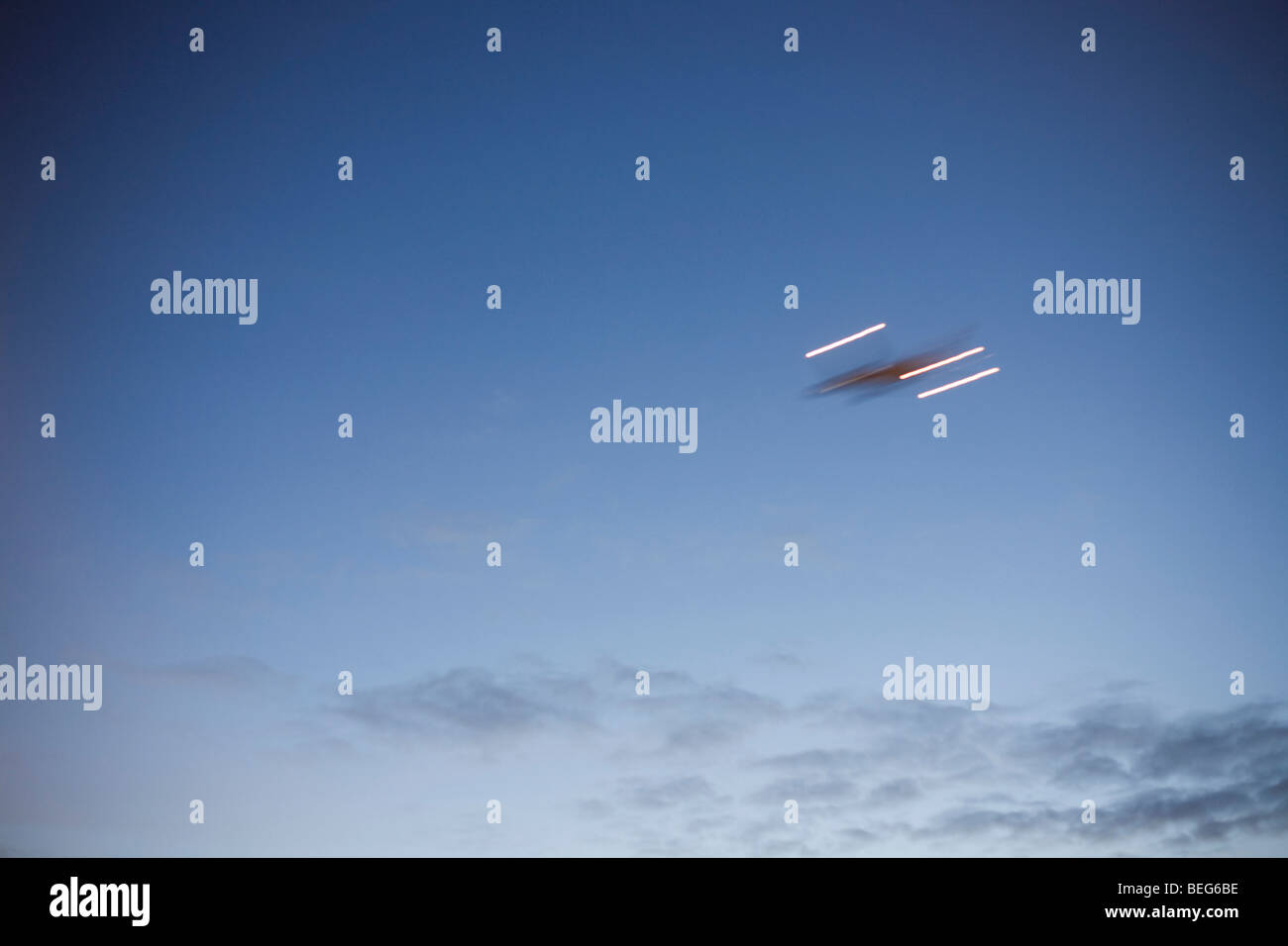 A blurred jet airliner climbs away after taking-off in clear skies above London's Heathrow Airport. - Stock Image