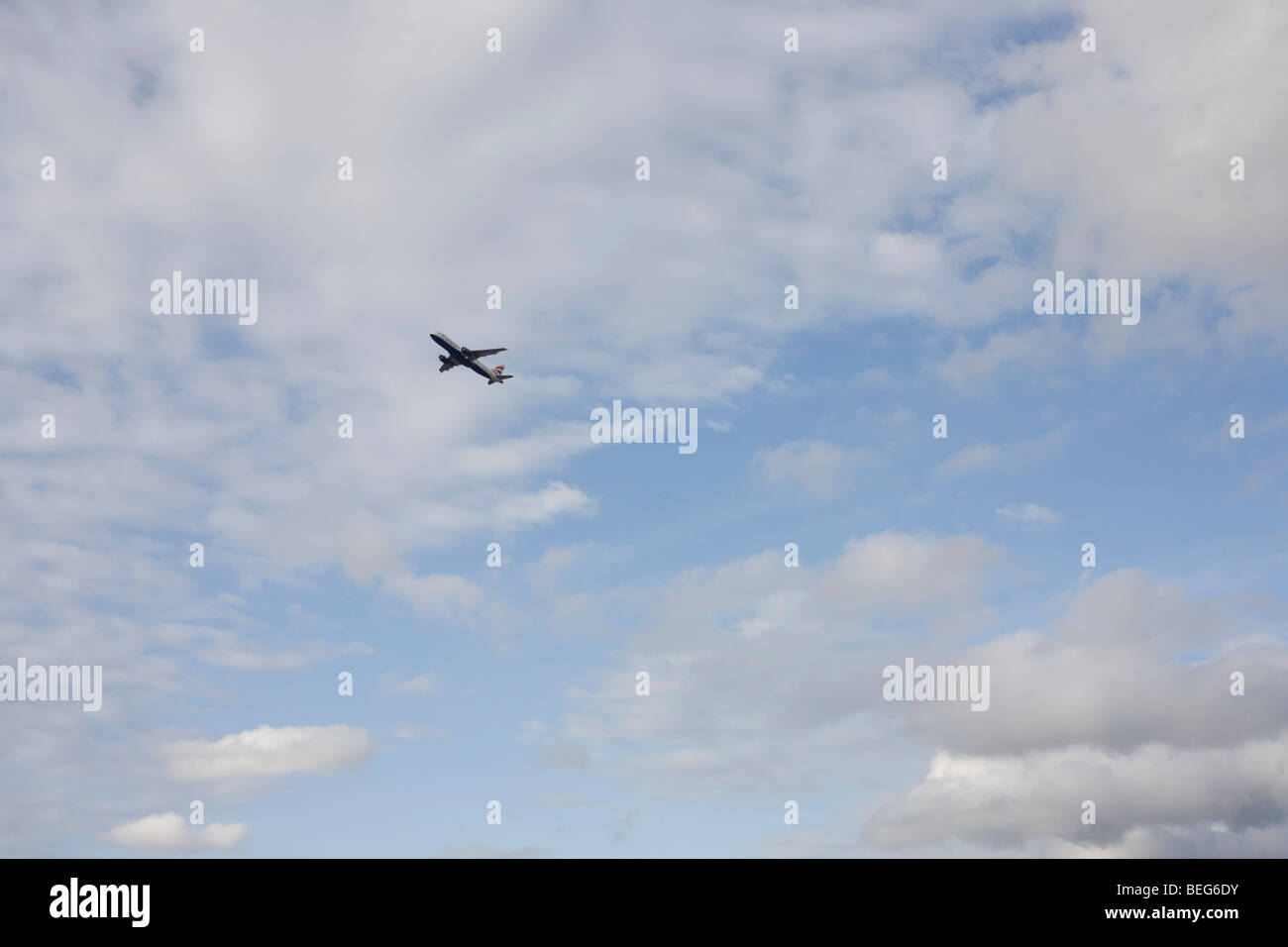 Sixth of a sequence of 8 consecutive images, a jet airliner takes-off over afternoon skies above London's Heathrow - Stock Image