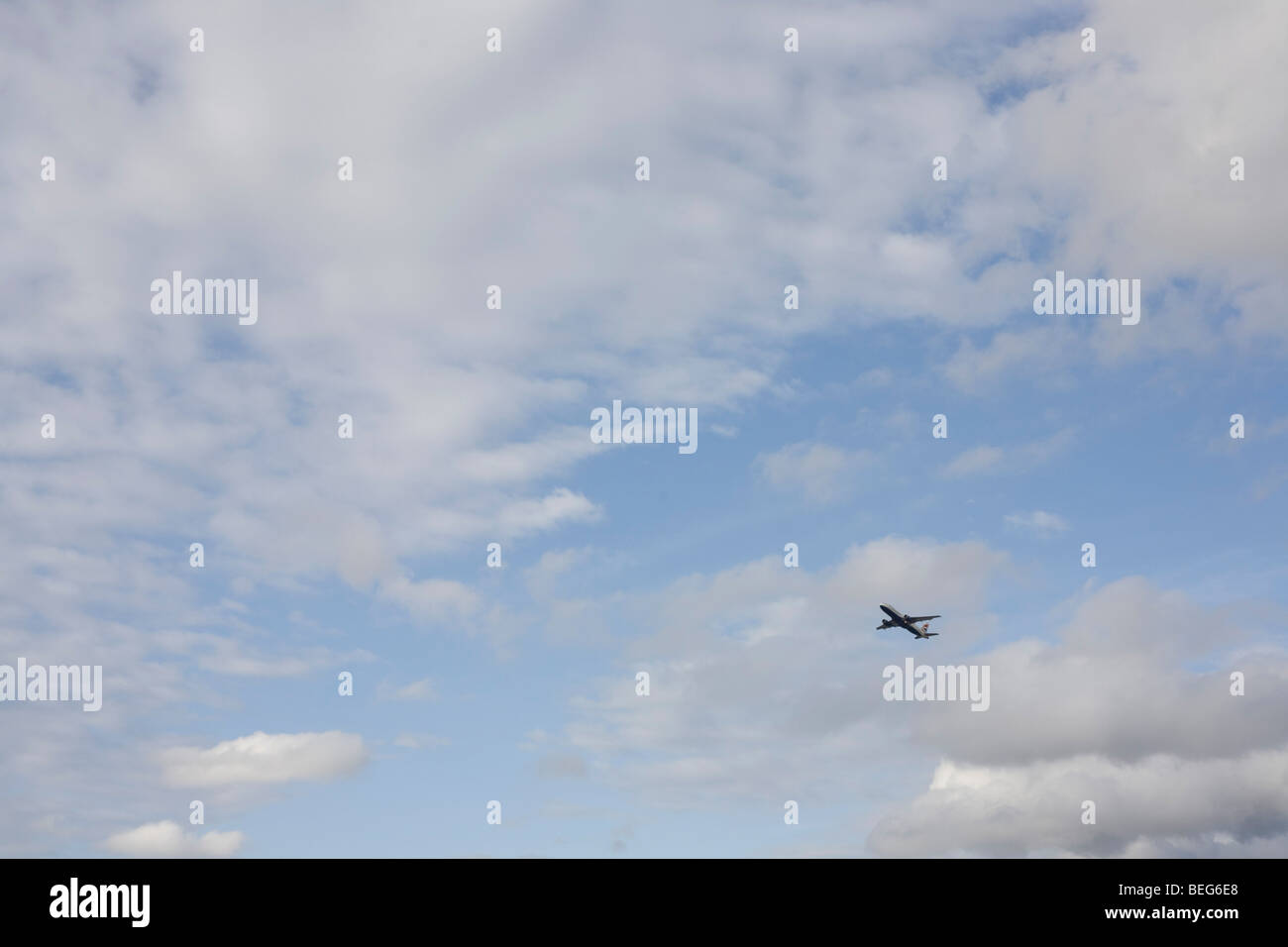 Third of a sequence of 8 consecutive images, a jet airliner takes-off over afternoon skies above London's Heathrow - Stock Image