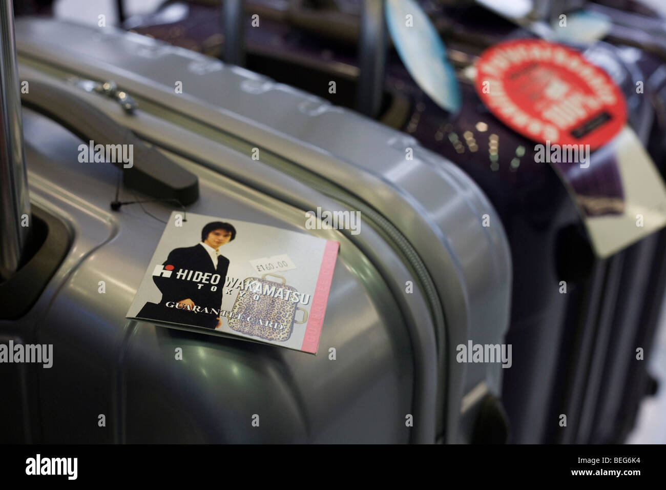 Hideo Wakamatsu Suitcases on sale at the Excess Baggage' shop in departures at Heathrow airport's terminal - Stock Image