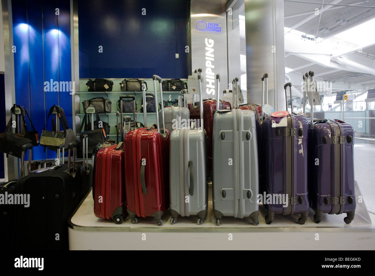 Suitcases on sale at the 'Excess Baggage' shop in departures at Heathrow airport's terminal 5. - Stock Image