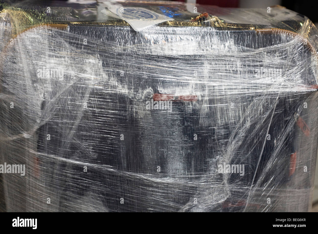 Secure shrink-wrapped baggage seen in Heathrow airport's terminal 5. - Stock Image