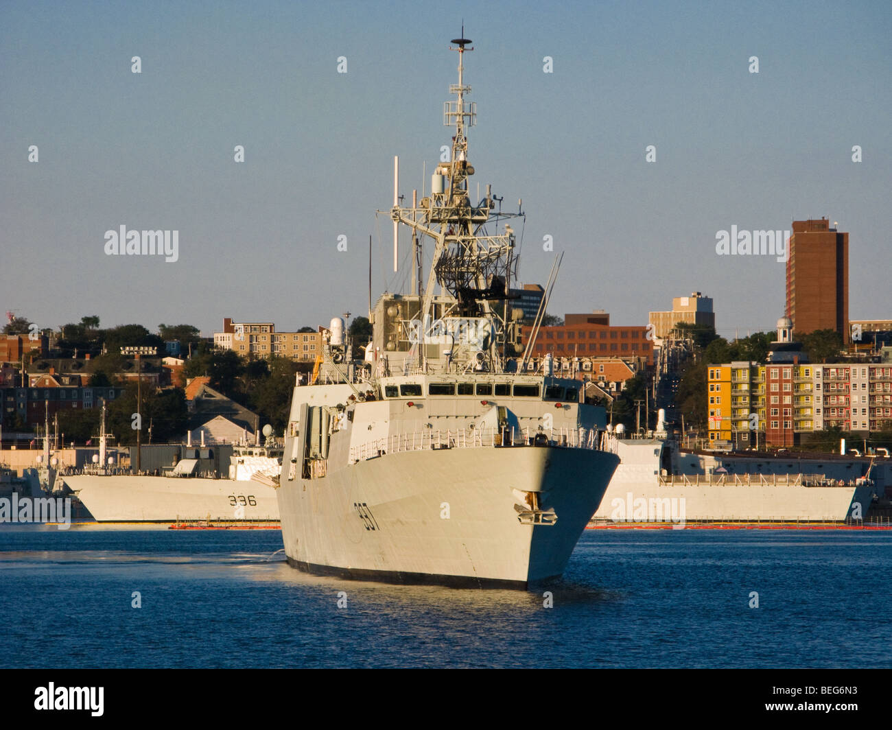 HMCS Fredericton in Halifax Harbour with sistership HMCS Montreal in the background. - Stock Image