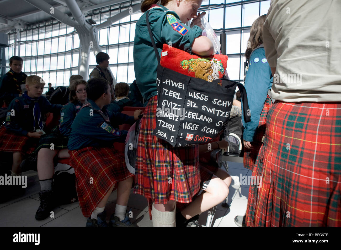 Scottish scout troupe passengers await their flight in departures at Heathrow's Terminal 5. Stock Photo