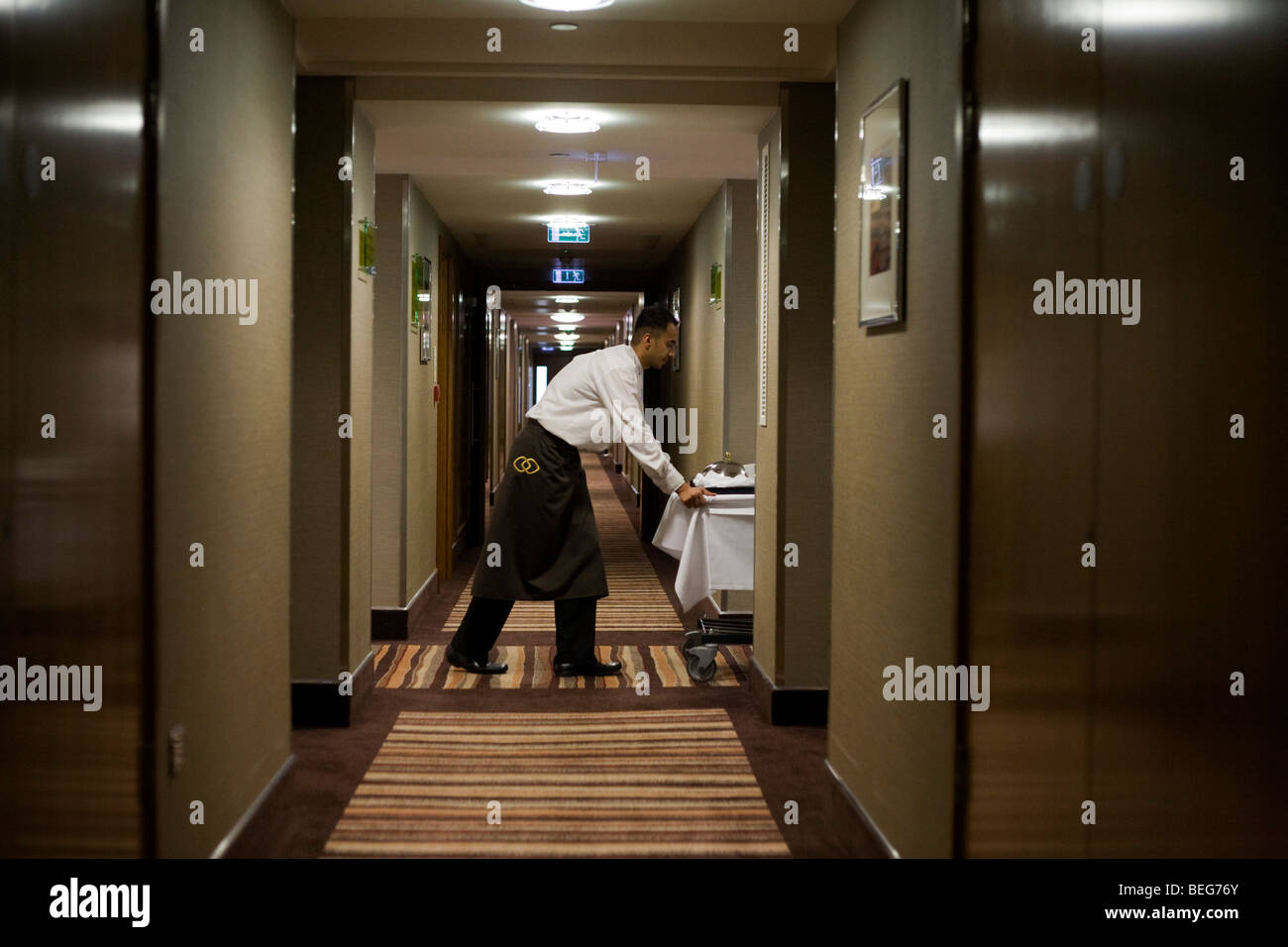 A hotel waiter delivers a meal ordered from room service in the Heathrow Airport Sofitel, attached to Terminal 5. Stock Photo