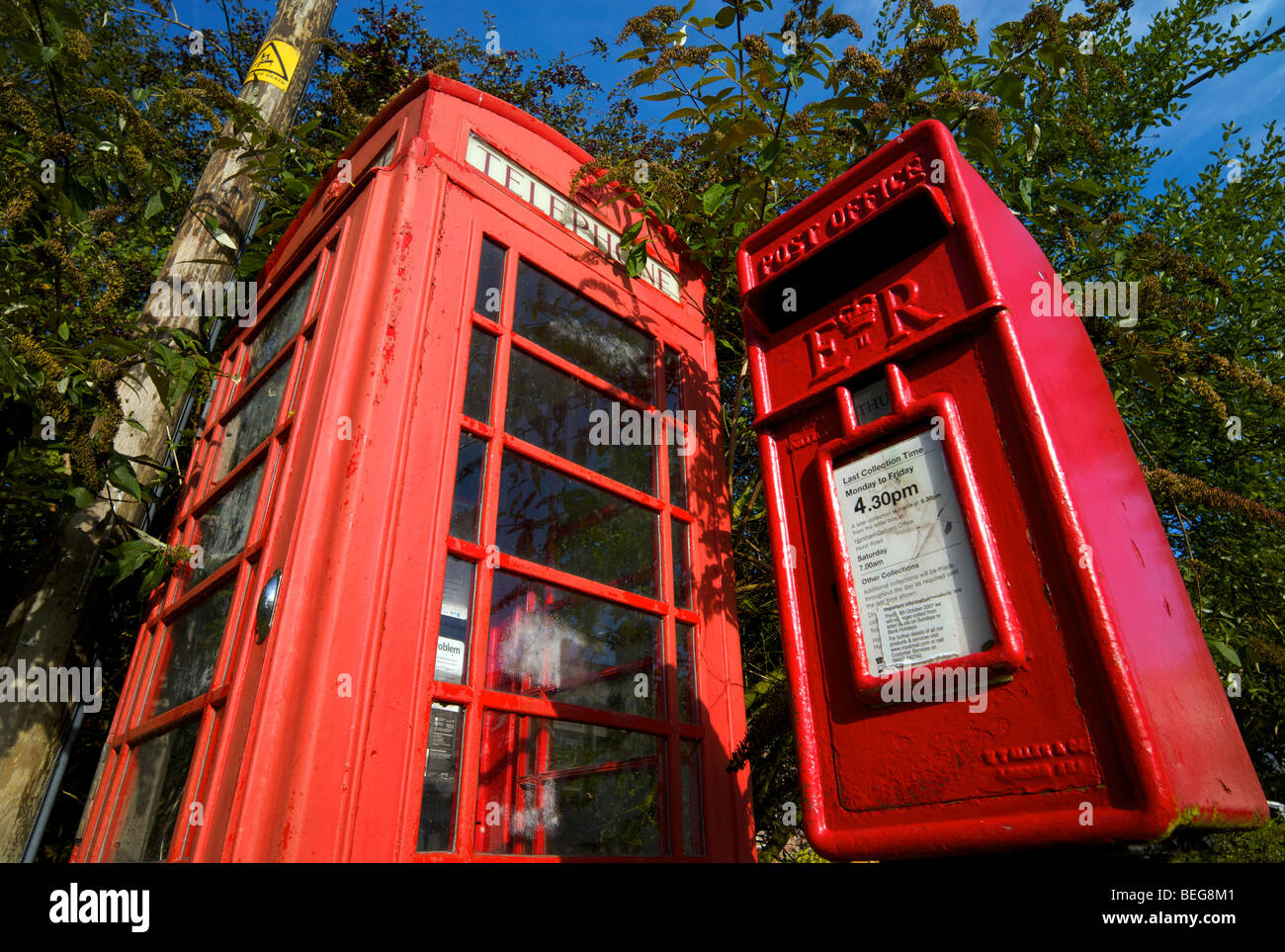 Old style telephone kiosk and post box in an English village in Sussex UK - Stock Image