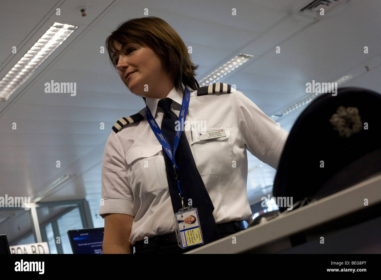 A lady pilot examines flight data and documents in the