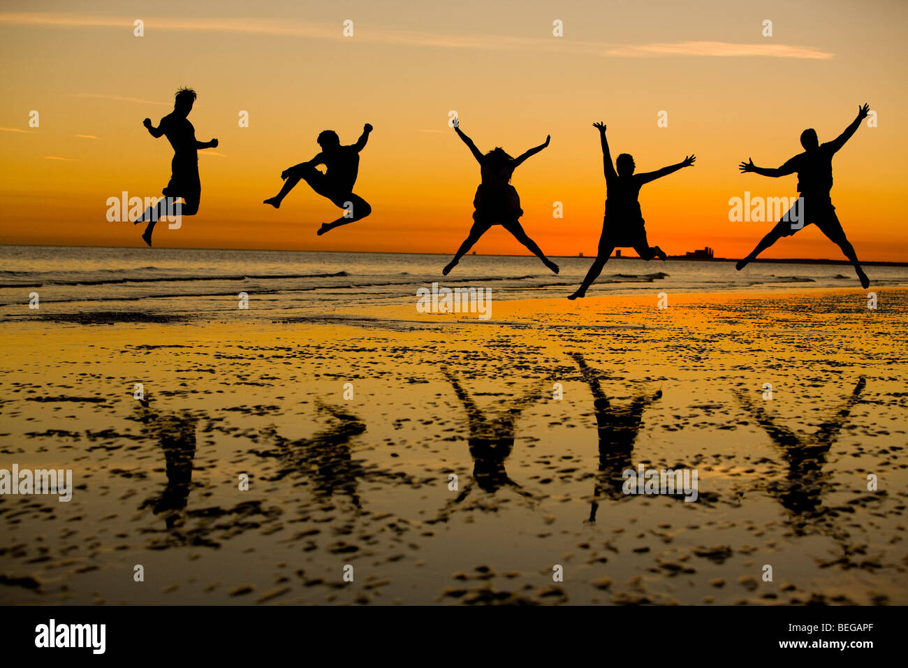 Friends enjoying a good time at the beach. - Stock Image