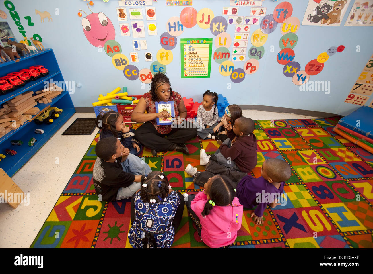 Detroit, Michigan - A teacher tells a story to children at the World of Wonders Child Care Center. Stock Photo
