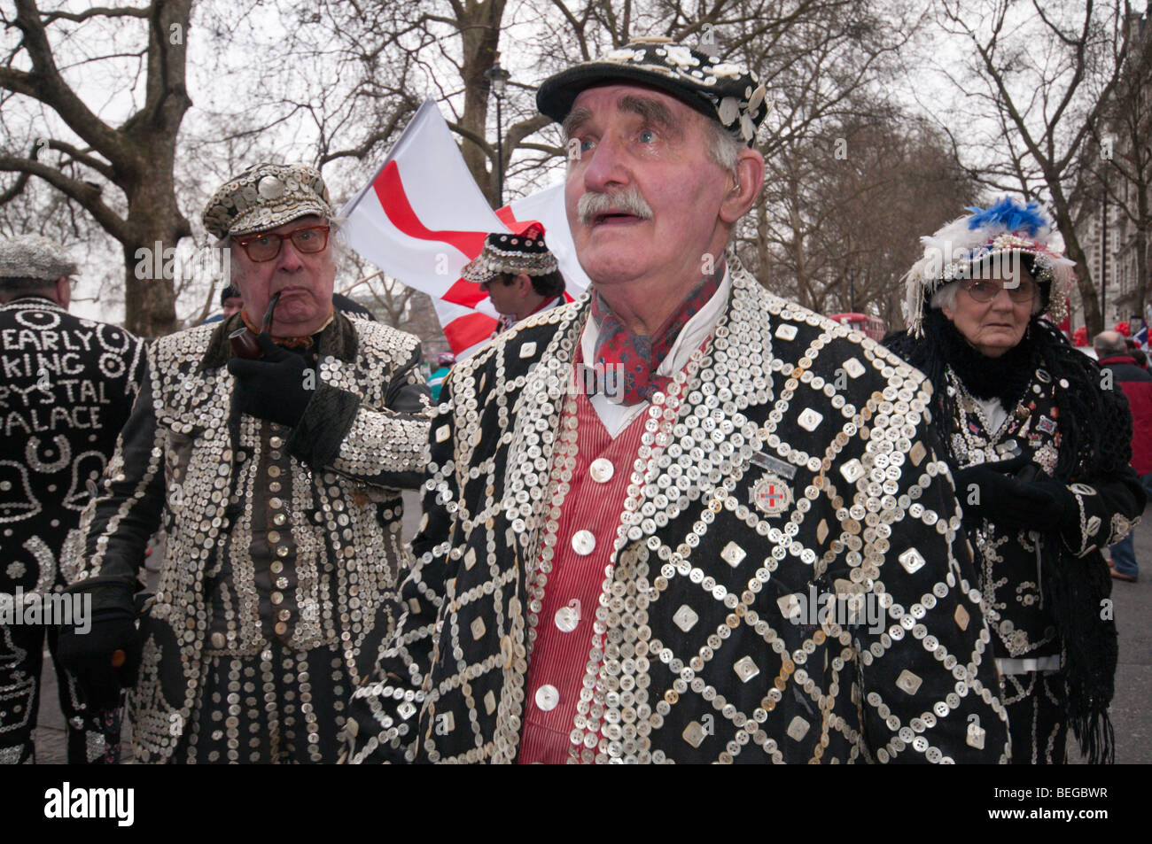 Pearly Kings and Queens wait for the start of the London New Year Parade, Westminster - Stock Image