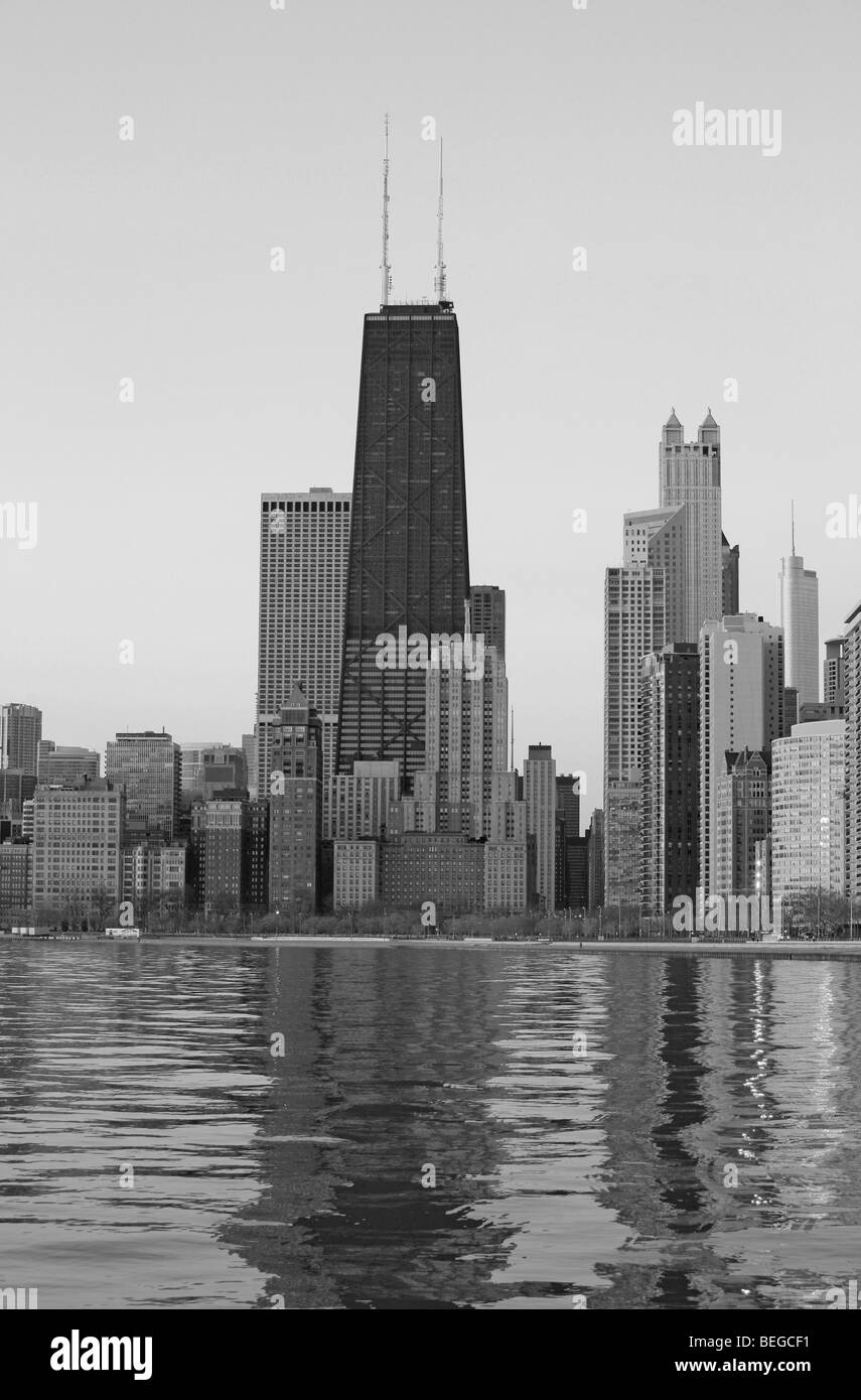 Downtown Chicago Illinois city skyline in the early light of dawn with Lake Michigan water reflection cityscape - Stock Image
