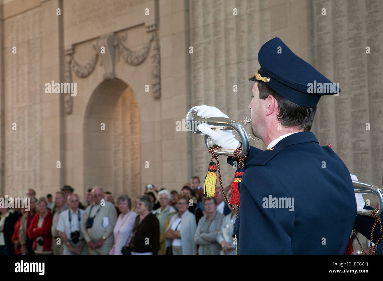 Bugler from the fire fighting corps playing the Last Post under the Menin Memorial Gate. - Stock Image