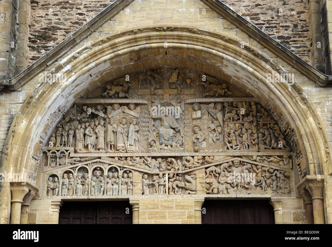 The doorway of the Church in the historic hillside village of Conques, France - Stock Image