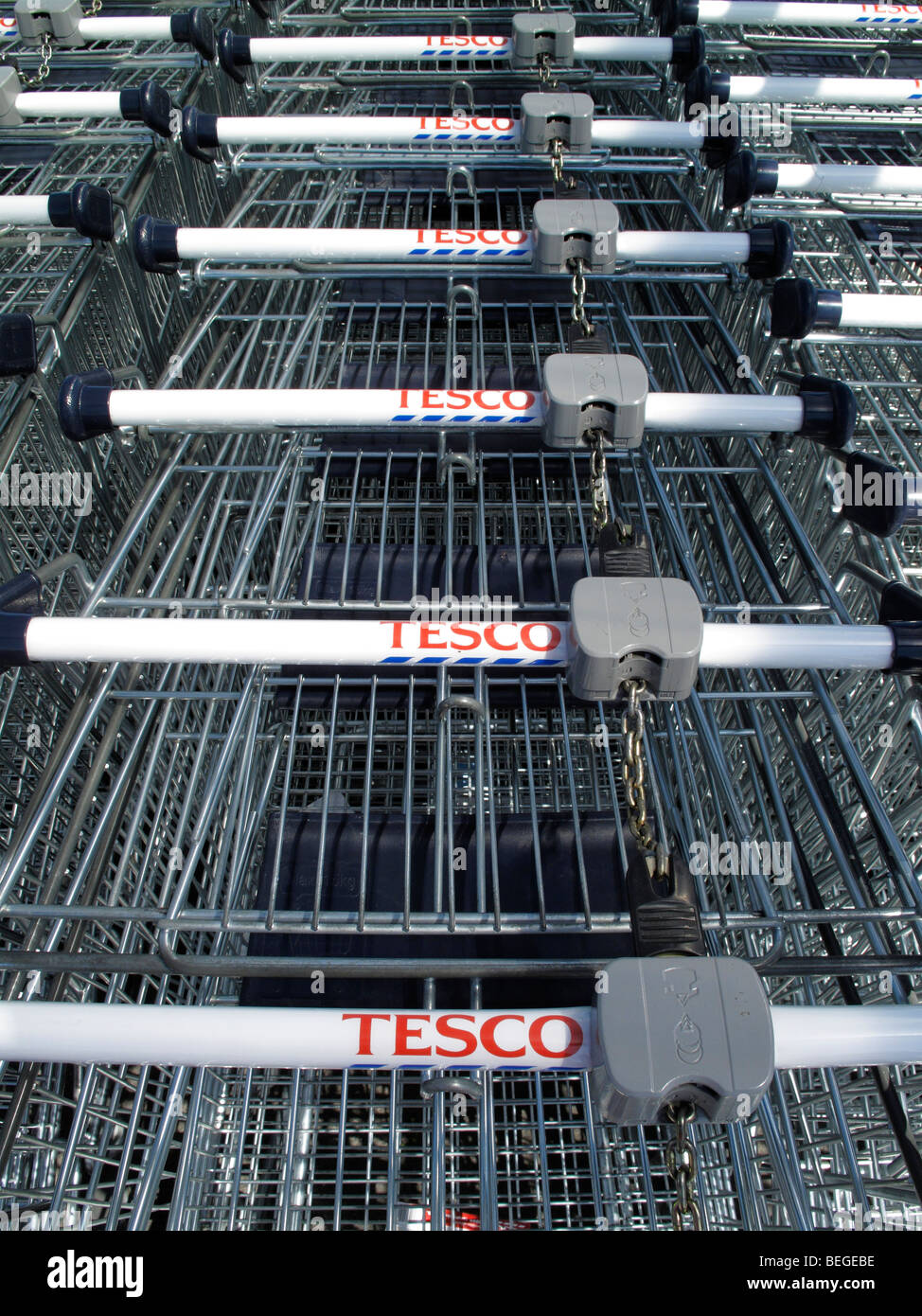 Shopping trolleys or carts for a Tesco supermarket - Stock Image