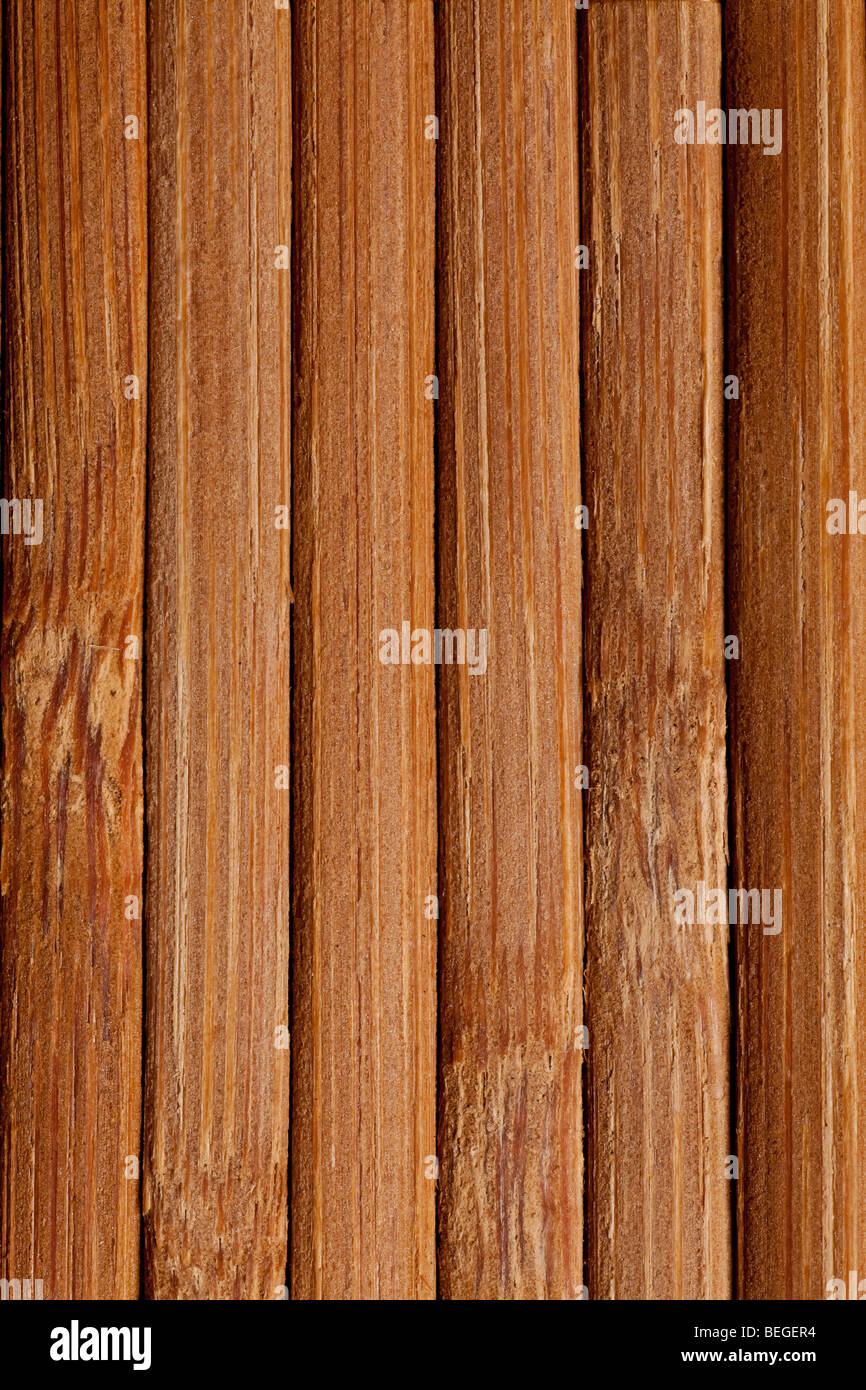natural bamboo slatted mat background in brown tones - Stock Image