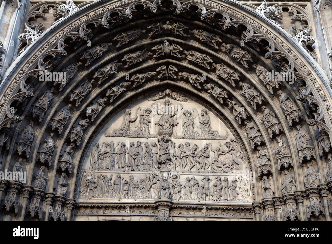 Carved doorway of the Cathedral showing the path to Heaven or Hell. - Stock Image