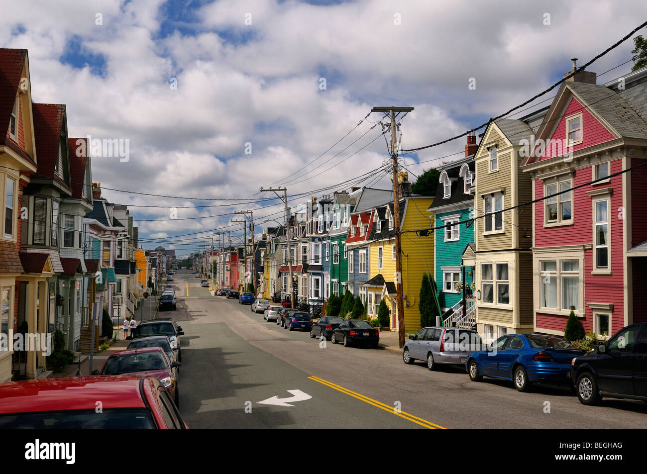 colorful clapboard houses on gower street in downtown st. Black Bedroom Furniture Sets. Home Design Ideas