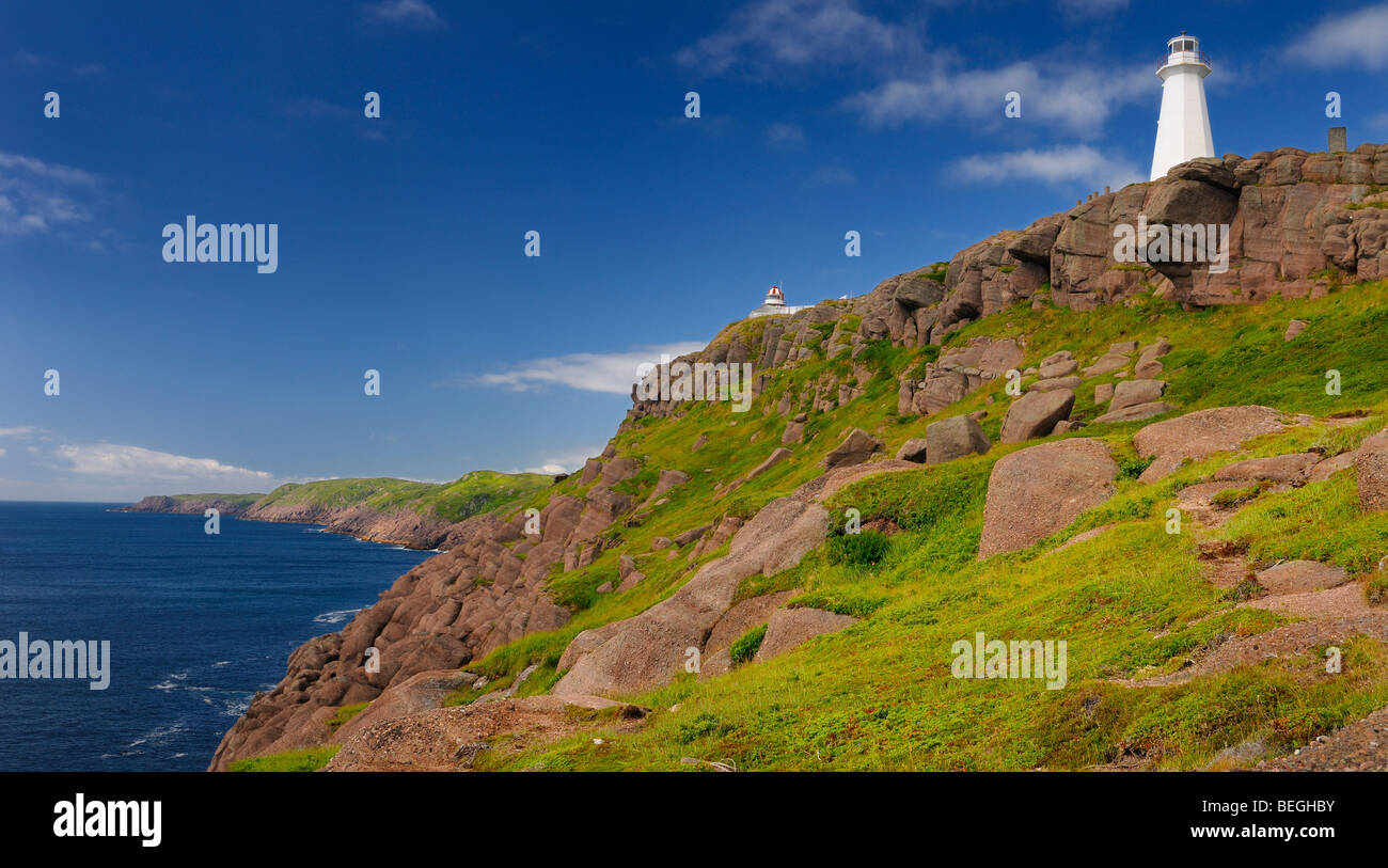 Oldest lighthouse in Newfoundland on left and new one at Cape Spear National Historic Site coastal cliffs on Atlantic - Stock Image