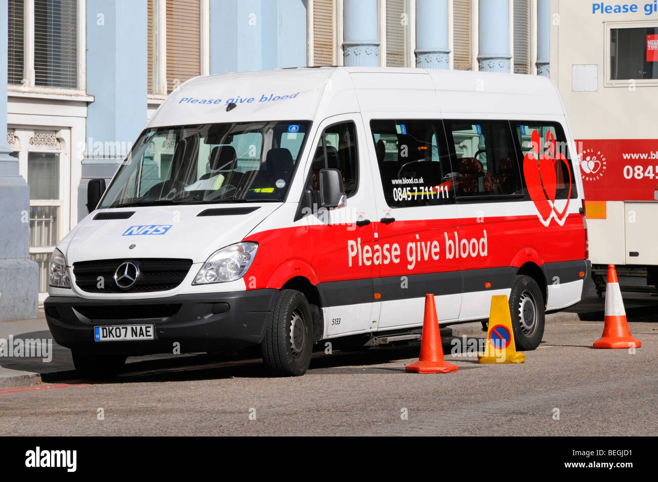 NHS Blood donor mobile collection vehicles parked in London street - Stock Image