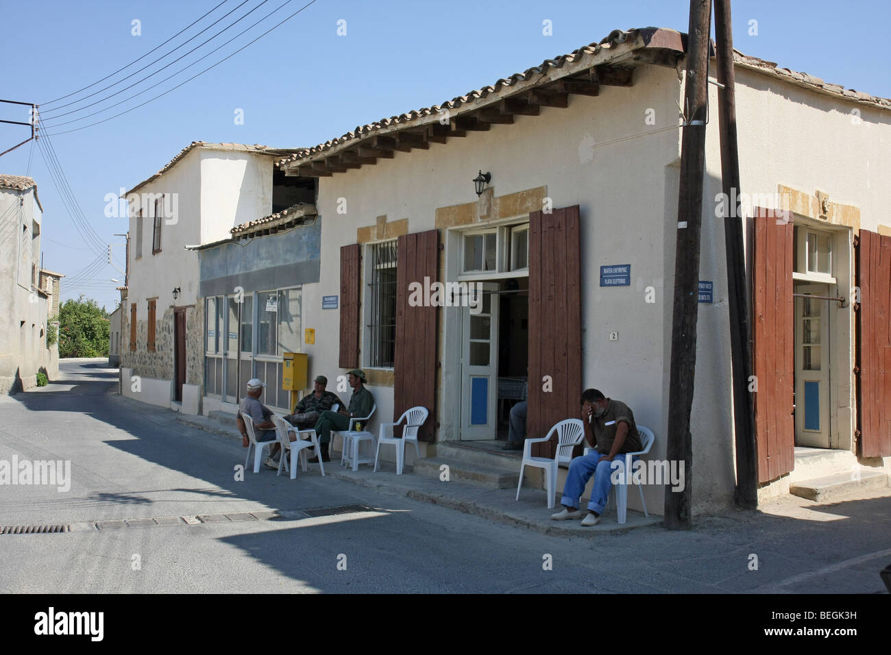 Local residents at the café in the small village of Pera, Cyprus. - Stock Image