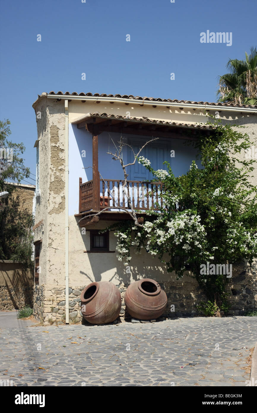 Large pots beside a house in the small village of Pera, Cyprus. - Stock Image