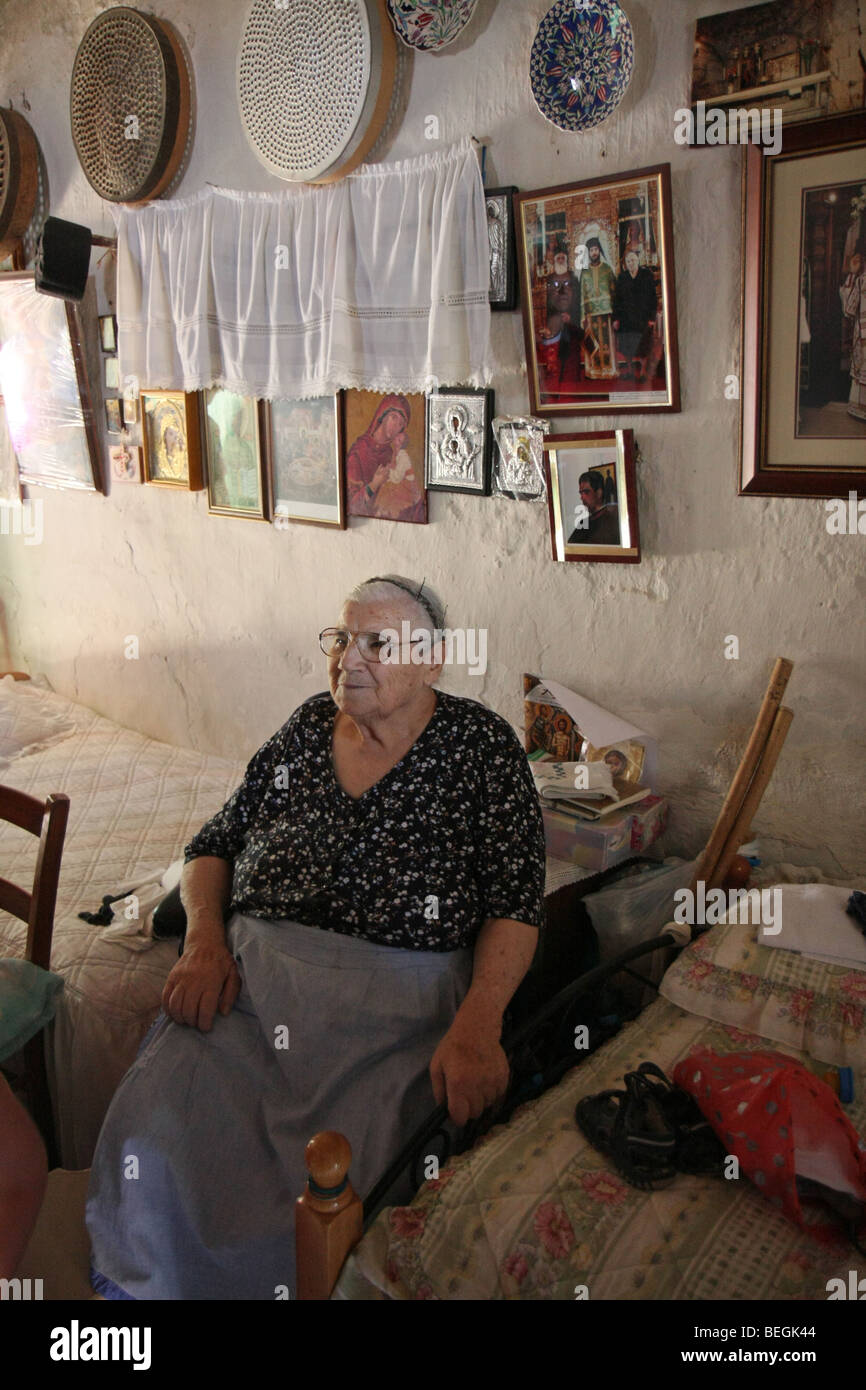 The wife to the old priest in the small village of Pera, Cyprus. - Stock Image