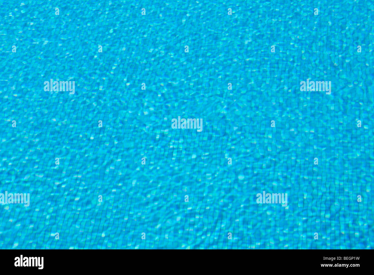 Blue tiles and ripples of water in a 'swimming pool' - Stock Image