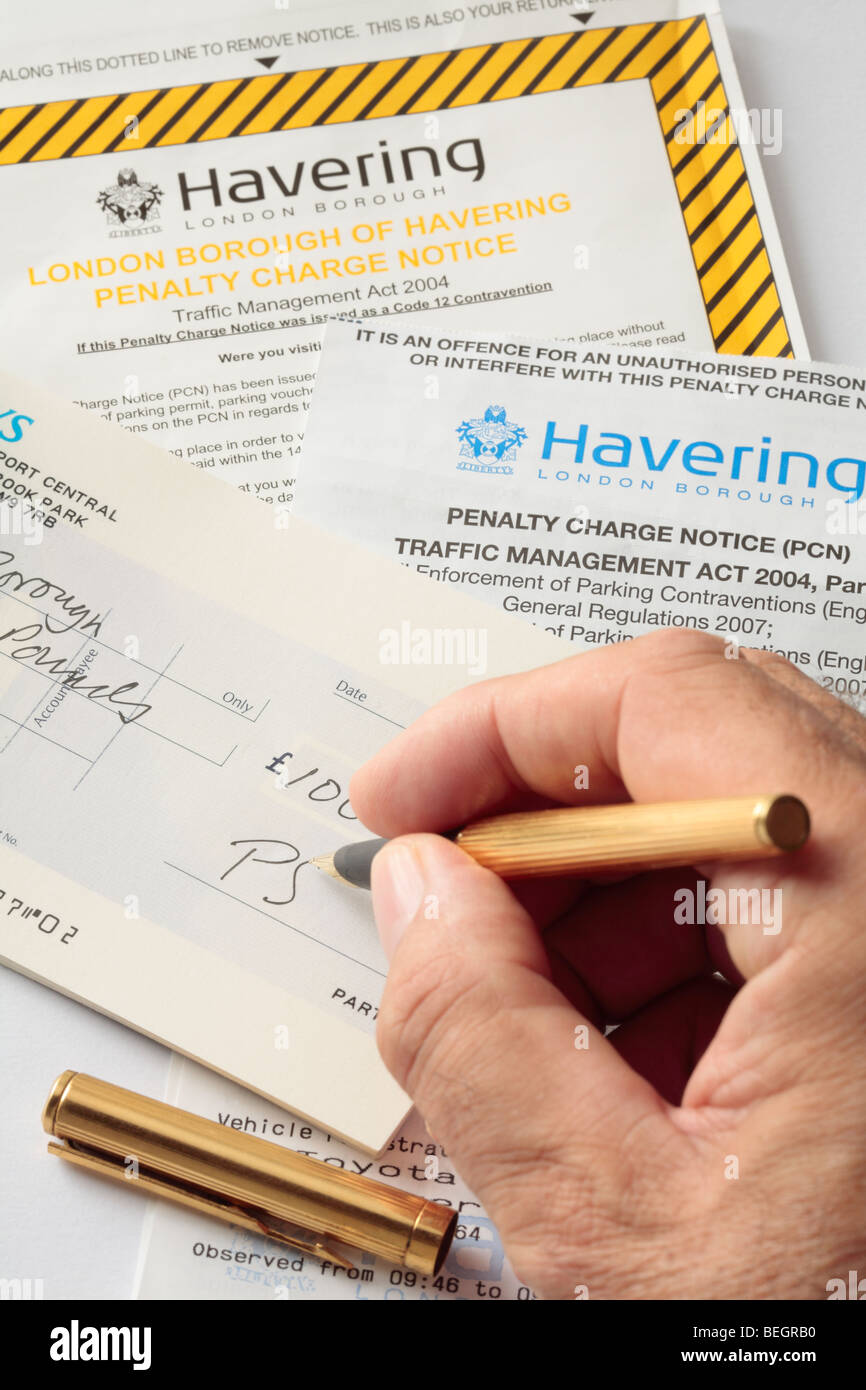 Writing Cheque to Pay a Penalty Charge Notice or Parking Fine. - Stock Image
