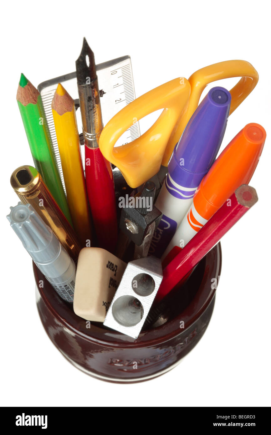 Pot of pens, pencils, scissors and assorted colourful stationery items. - Stock Image