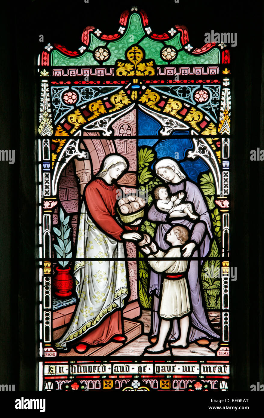 A stained glass window depicting the parable of the sheep and goats, Church of St Mary the Virgin, Gunthorpe, Norfolk - Stock Image