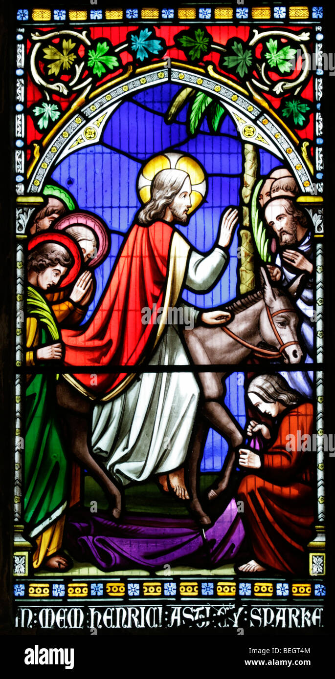 A stained glass window depicting Jesus entering Jerusalem on a donkey, Church of St Mary the Virgin, Gunthorpe, - Stock Image