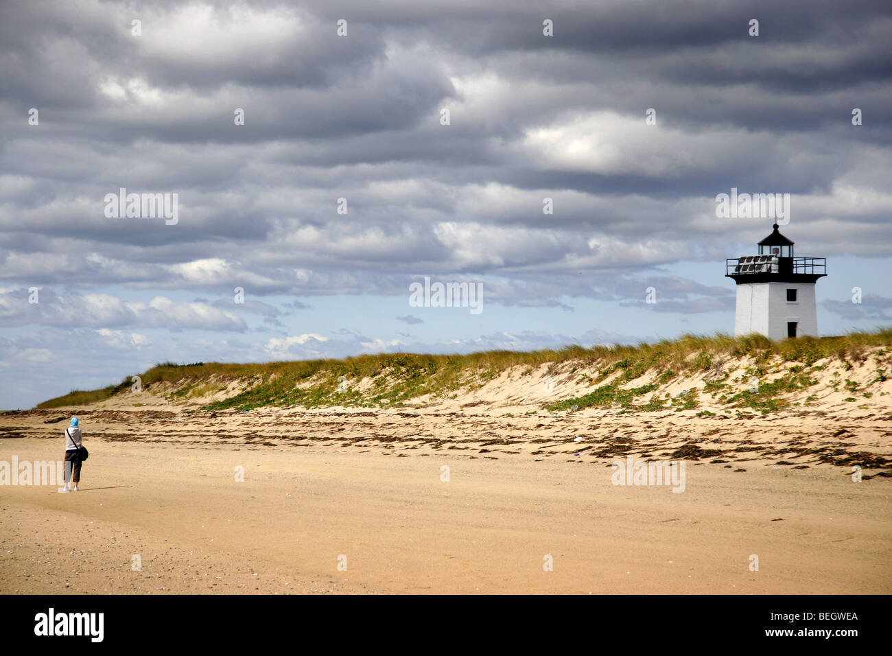 Girl on Long Point beach by Wood End Lighthouse, Provincetown, Cape Cod, New England, Massachusetts, USA - Stock Image