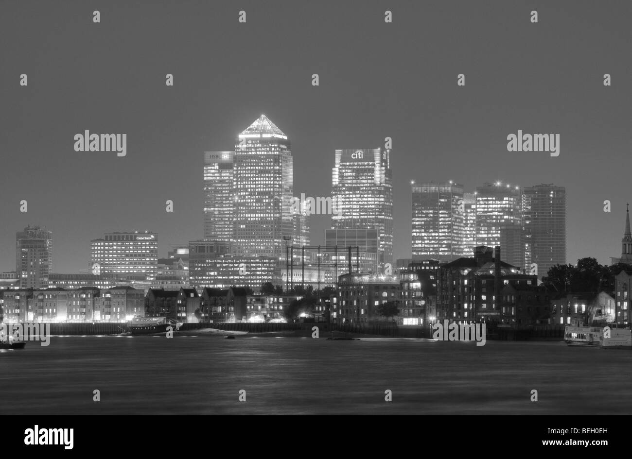 London Docklands from across the Thames at night. - Stock Image