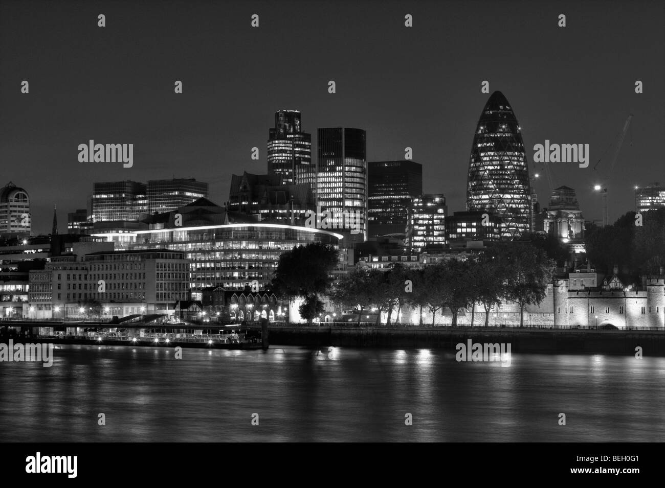 The City of London at night from across the River Thames. Black and white shot, taken in Summer 2009. - Stock Image
