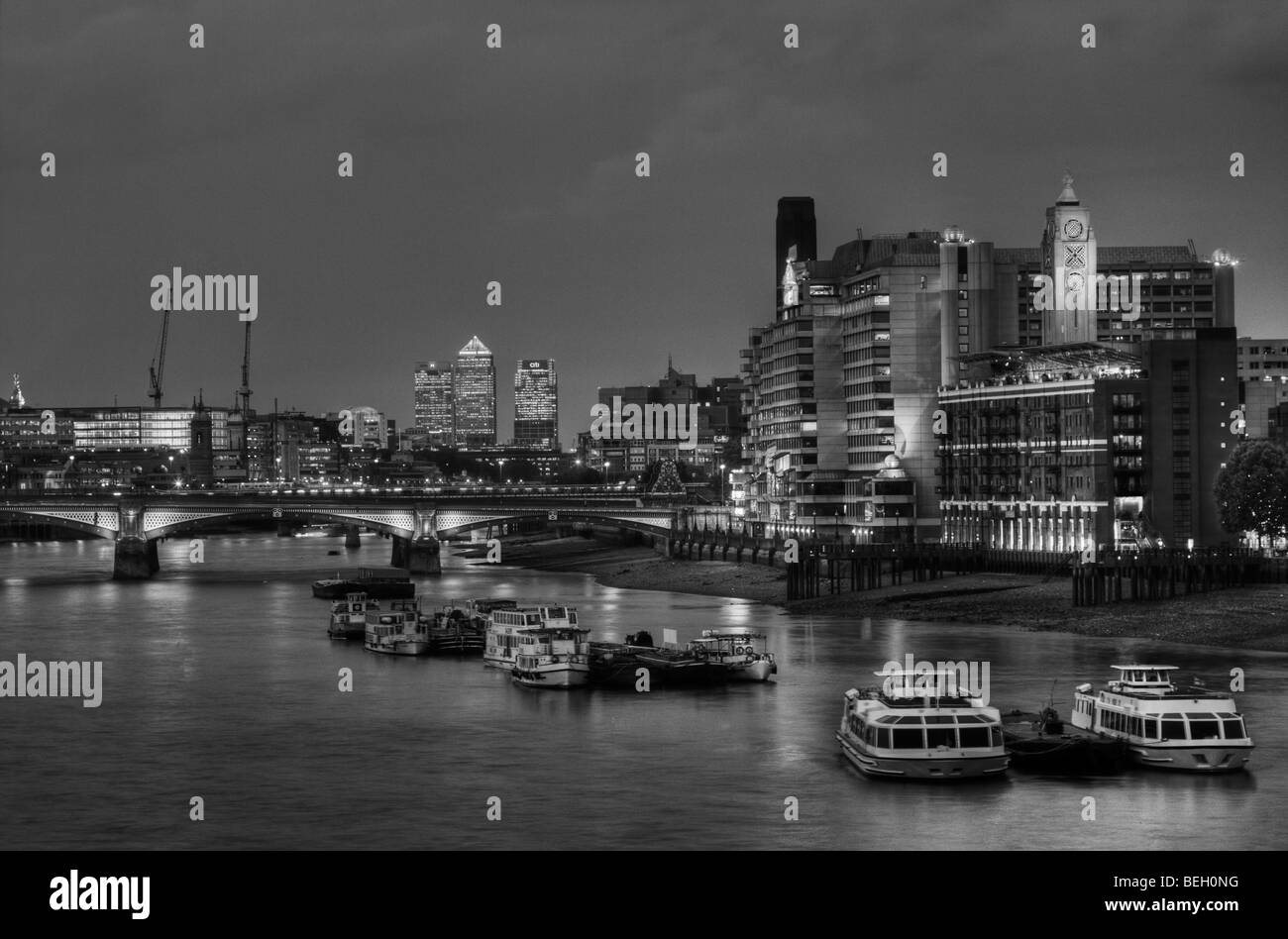Oxo Cafe on the Southbank and Docklands viewed at night from Waterloo Bridge in London England. - Stock Image
