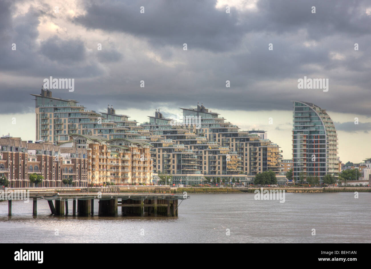 Battersea Reach viewed from across the River Thames, with the heliport in view. - Stock Image
