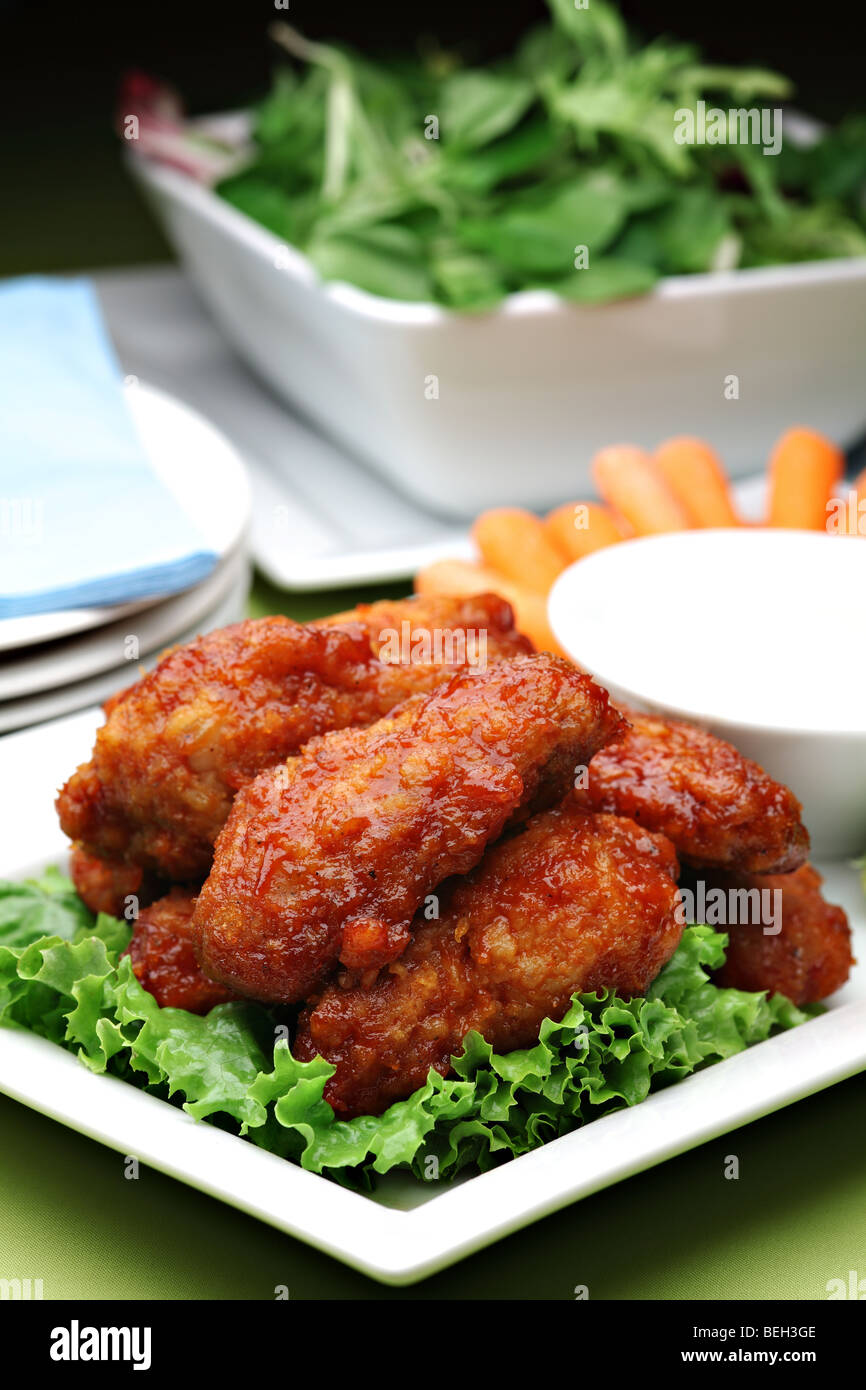 Hot spicy buffalo style chicken wings - Stock Image