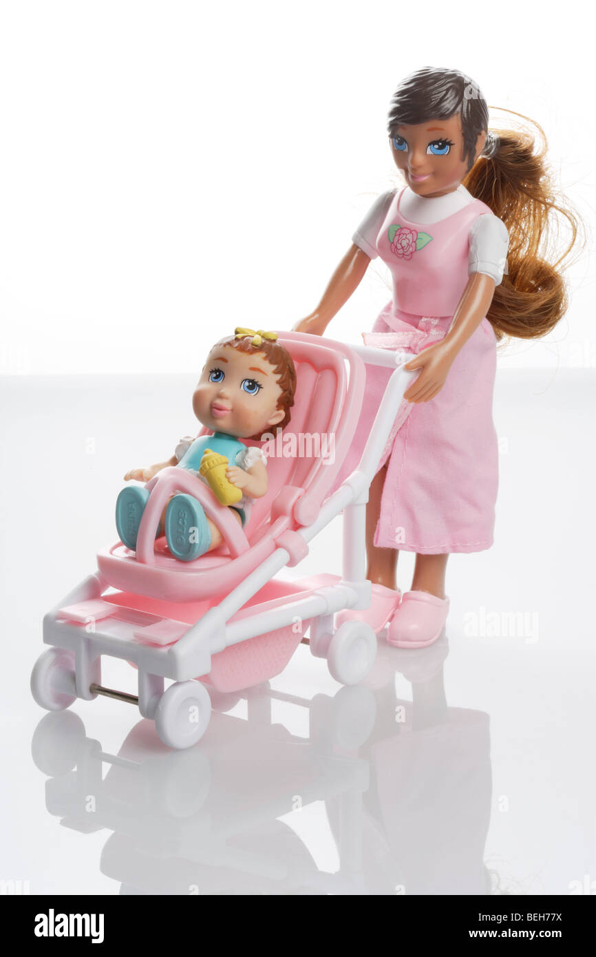 Mother doll with baby girl doll in a miniature pushchair buggy Stock Photo
