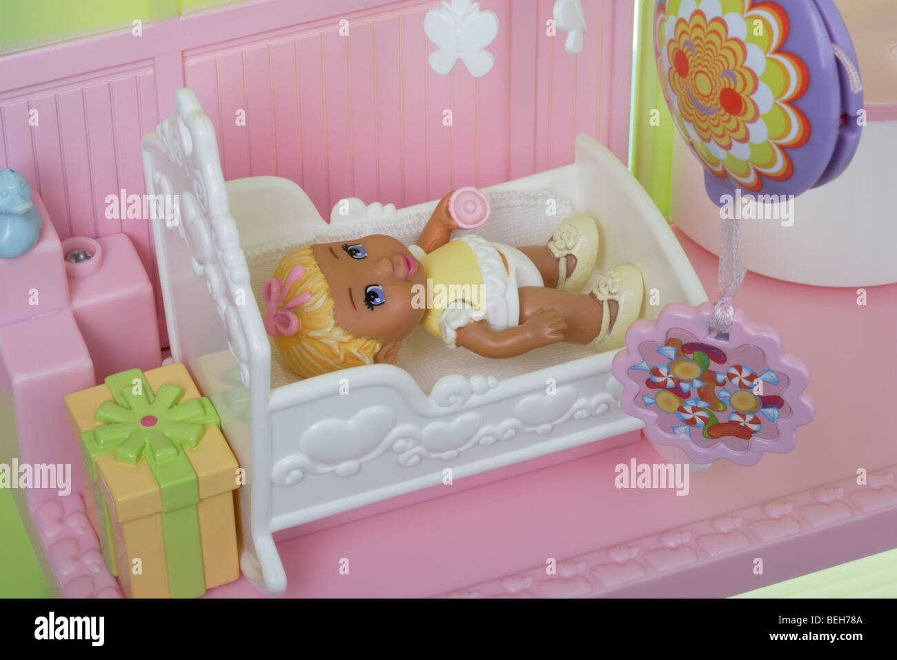 Baby girl doll in her cot - Stock Image