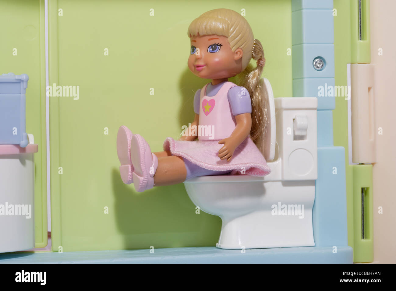 Girl child doll in the bathroom Stock Photo