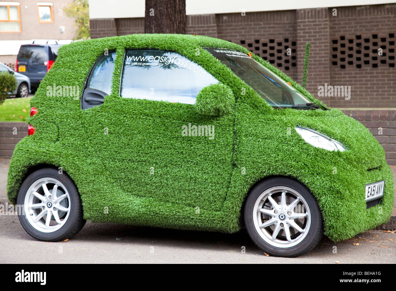 Smart Car Covered In Artificial Grass In Street London Uk
