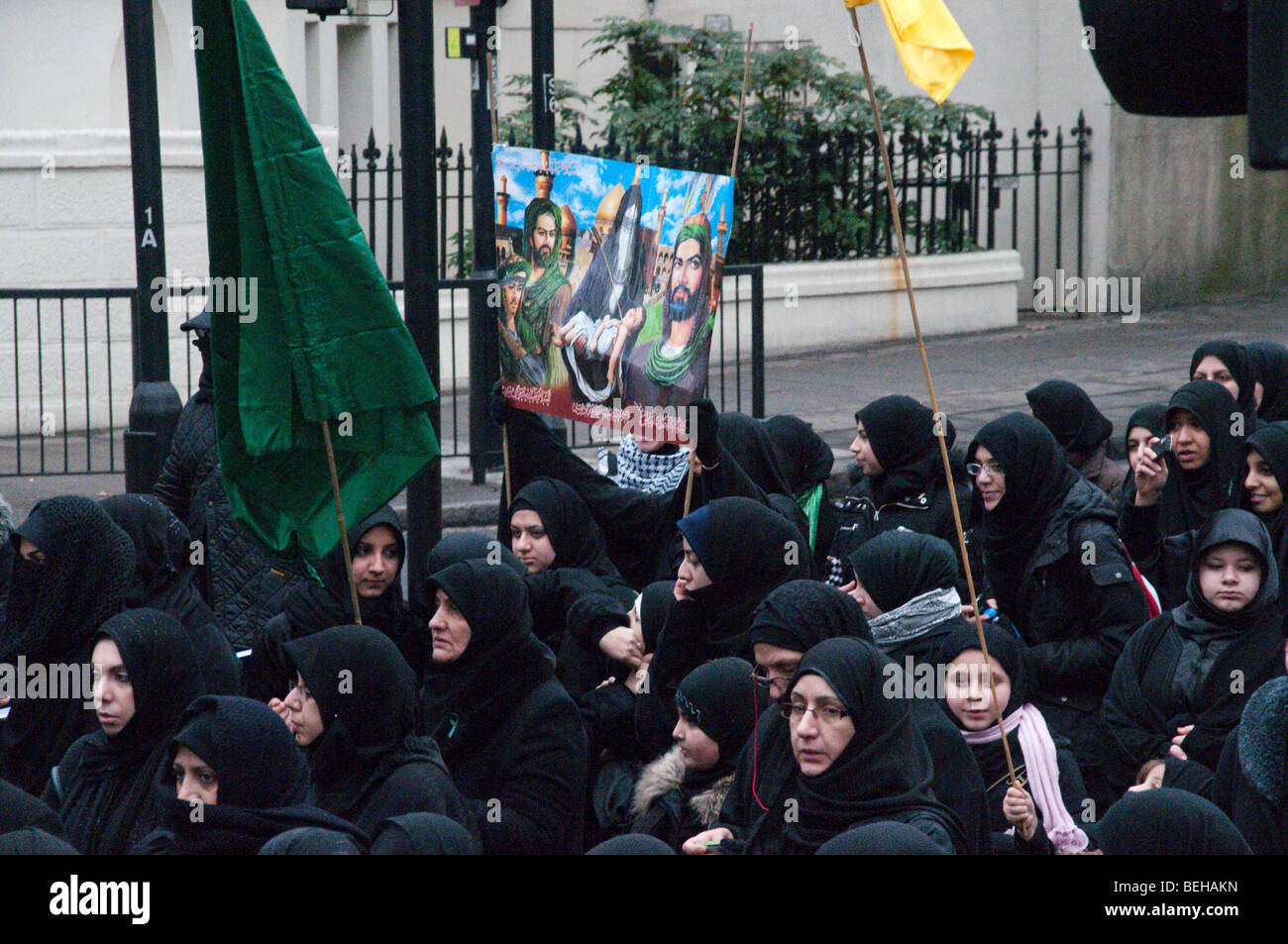 Shi'ite Muslims in annual Ashura Procession, London -  women with banner - Stock Image