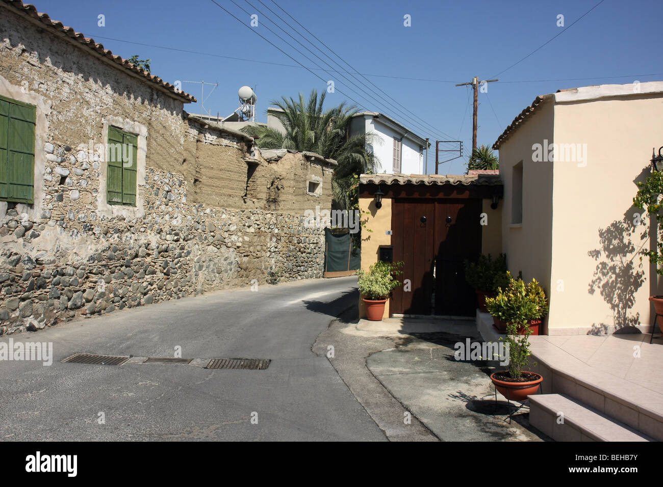 Street with houses in the small village of Pera, Cyprus. - Stock Image