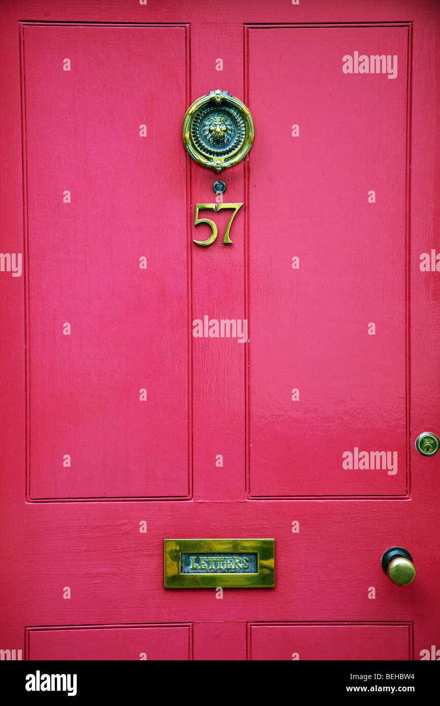 pink front door, door knocker Stock Photo