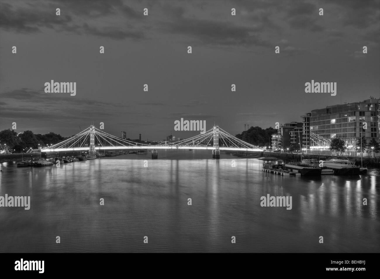 Albert Bridge and the river Thames, at night - Stock Image