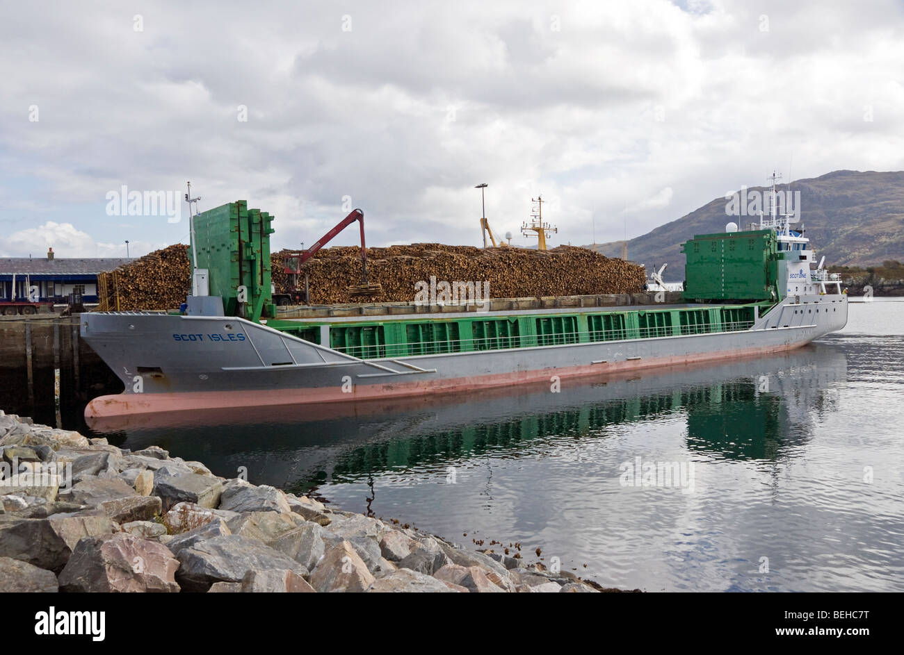 Scot Isles loading timber in Kyle of Lochalsh harbour Scotland - Stock Image